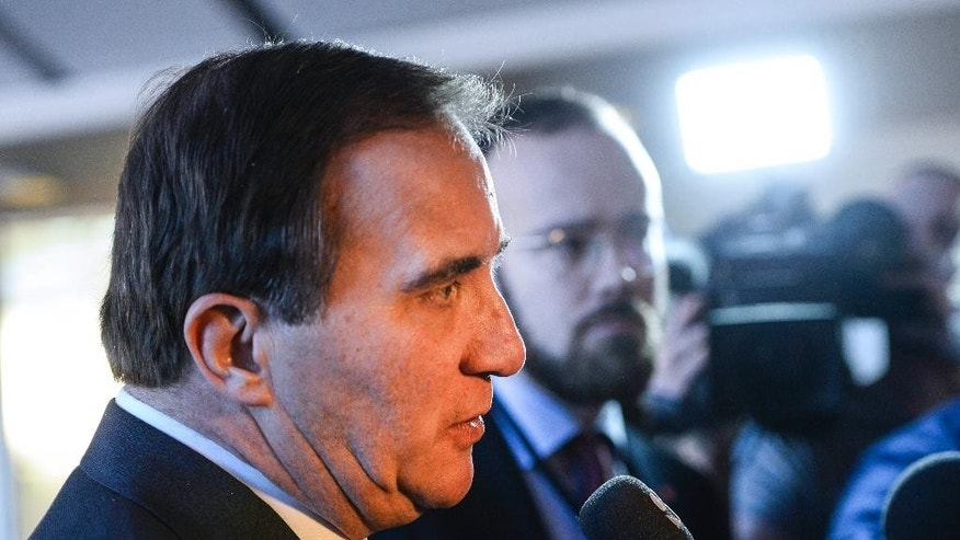 Swedish Prime Minister and Social Democratic Party  leader Stefan Löfven answers questions after a press conference at the Swedish Parliament in Stockholm, Sweden, December 27, 2014. During the presser it was announced that a 'December agreement' on how to rule with a minority government in the parliament, has canceled the plans to run a snap election in March 2015.  (AP Photo / Henrik Montgomery / TT)   SWEDEN OUT