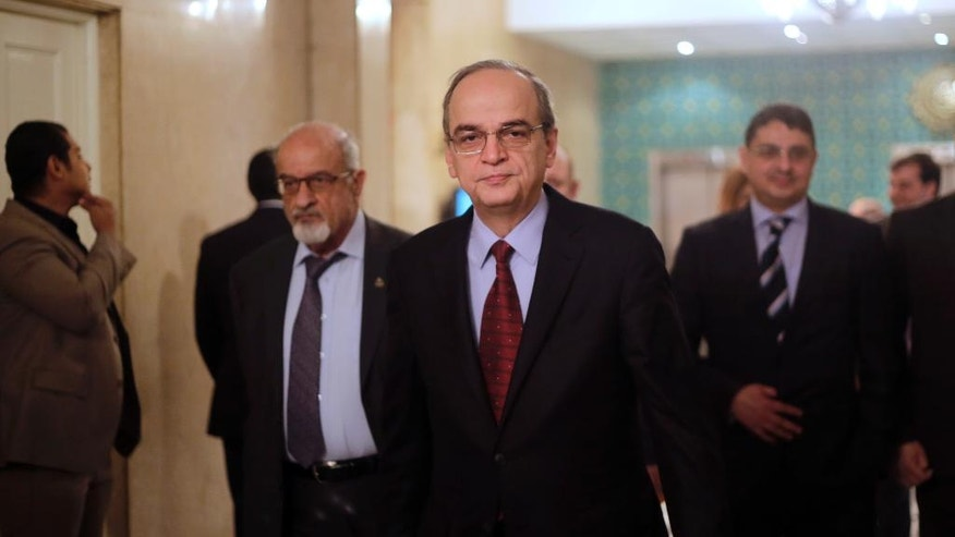 Hadi Bahra, the head of the Syrian National Coalition, the country's main political opposition group, leaves a meeting with Arab League's Secretary-General Nabil Elaraby at the league's headquarters in Cairo, Egypt, Saturday, Dec. 27, 2014. (AP Photo/Amr Nabil)