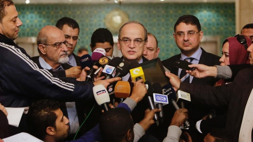 Hadi Bahra, the head of the Syrian National Coalition, the country's main political opposition group, speaks during a press conference following his meeting with the Arab League's Secretary-General Nabil Elaraby at the league's headquarters in Cairo, Egypt, Saturday, Dec. 27, 2014. (AP Photo/Amr Nabil)