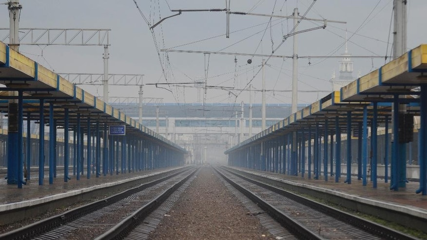 An empty railway station is seen in Simferopol, Crimea, Saturday, Dec. 27, 2014. Ukraine on Friday blocked rail and bus travel between the mainland and the peninsula that was annexed by Russia in March. On Saturday, the Crimean customs service said automobiles also were blocked at two of the three crossing points on the isthmus leading to Crimea, but traffic resumed in late afternoon. (AP Photo/Anton Volk)