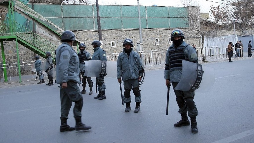 In this picture taken on Friday, Dec. 12, 2014, Afghanistan's police officers stand guard near the French Cultural Center, which was targeted by a suicide attacker in Kabul, Afghanistan. As U.S. and international combat troops leave Afghanistan after more than 13 years fighting the Talban, Afghan policemen are dying in record numbers as they perform dangerous tasks usually reserved for the military, according to the head of the European-funded mission to train the police force. (AP Photo/Massoud Hossaini)