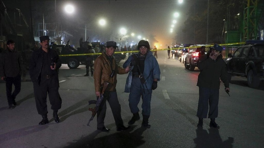 In this picture taken on Thursday, Dec. 11, 2014, Afghanistan's police officers stand watch near the French Cultural Center, which was targeted by a suicide attacker in Kabul, Afghanistan. The country has 157,000 police in a force created, trained and funded by the European Union. Almost every day, Afghan authorities report the deaths of policemen in Taliban assaults on checkpoints around rural towns and on the outskirts of larger cities. The police receive little backup from the army and do not have air support, medical evacuation or dedicated hospitals that could help reduce deaths, said Karl Ake Roghe, the outgoing head of EUPOL, the European Union Police Mission in Afghanistan. (AP Photo/Massoud Hossaini)