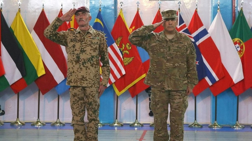Commander of the International Security Assistance Force (ISAF), Gen. John Campbell, right, and ISAF Gen. Hans-Lothar Domrose attend a ceremony at the ISAF headquarters in Kabul, Afghanistan, Sunday, Dec. 28, 2014. The United States and NATO formally ended their war in Afghanistan on Sunday with the ceremony at their military headquarters in Kabul as the insurgency they fought for 13 years remains as ferocious and deadly as at any time since the 2001 invasion that unseated the Taliban regime following the Sept. 11 attacks. (AP Photo/Massoud Hossaini)