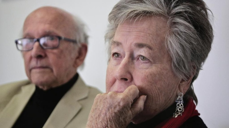 Parents of Al-Jazeera English journalist Australian Peter Greste, Juris Greste, left, and  Lois Greste, right, listen during an interview with The Associated Press in Cairo, Egypt, Monday, Dec. 29, 2014. A year after three Al-Jazeera English journalists were arrested in Egypt, they and their families are pleading for justice and an end to their ordeal. (AP Photo/Amr Nabil)