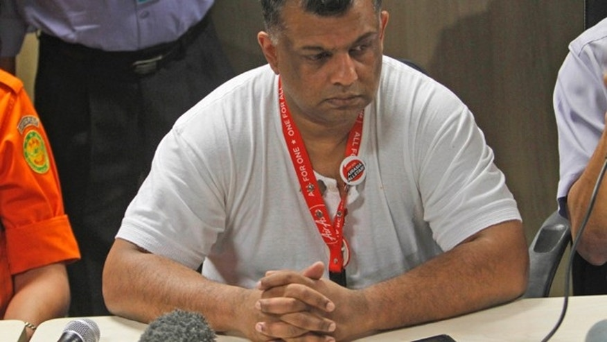 Dec. 28, 2014: AirAsia Group CEO Tony Fernandes listens during a press conference at Juanda International Airport in Surabaya, East Java, Indonesia. (AP Photo/Trisnadi)