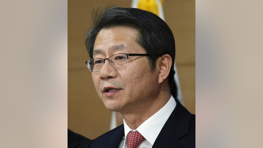 South Korean Unification Minister Ryoo Kihl-jae speaks during a press conference at the government complex in Seoul, South Korea, Monday, Dec. 29, 2014. South Korea on Monday proposed talks with North Korea to discuss what it calls a range of issues needed to prepare for the unification of the divided countries.(AP Photo/Yonhap, Chun Soo-young)  KOREA OUT