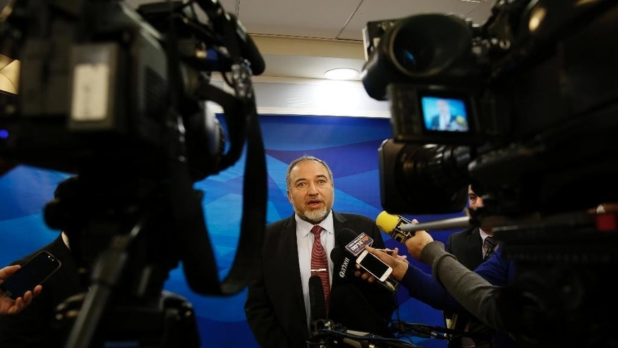 FILE - In this Dec. 28, 2014 file photo, Israel's Minister of Foreign Affairs Avigdor Lieberman, speaks to the media ahead of the weekly cabinet meeting in Jerusalem. A  corruption investigation that has roped in 30 Israeli public figures and politicians linked to the Lieberman's Yisrael Beitenu party has shaken up the campaign ahead of March elections, throwing the hard-line party's future into disarray.  (AP Photo/Gali Tibbon, File)