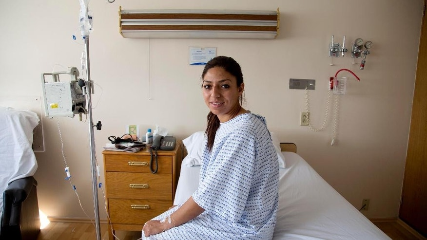 "Karla Sanchez San Martin, one of Mexico's few female bullfighters, poses for a portrait in her hospital bed in Mexico City, Tuesday, Dec. 30, 2014. Sanchez, who goes by the name Karla de los Angeles as a bullfighter, suffered a pair of gashes to the thigh and buttock when she was gored twice by a bull on Sunday but says she's determined to return to the ring by mid-January, two days after she and several others were gored by what she described as a ""very smart"" bull. (AP Photo/Eduardo Verdugo)"