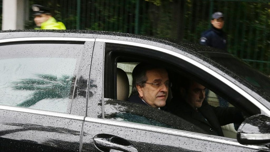 Greece's Prime Minister Antonis Samaras leaves Presidential Palace after a meeting with Greek President Karolos Papoulias in Athens, Tuesday, Dec. 30, 2014. Parliament failed to elect a new Greek president after three rounds of voting, triggering an early general election on Jan. 25, which could see a pro-bailout coalition lose power. (AP Photo/Thanassis Stavrakis)