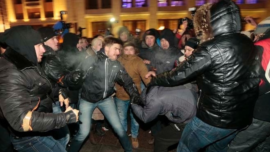 Dec. 30, 2014: Supporters and opponents of Russian opposition activist and anti-corruption crusader Alexei Navalny clash during unsanctioned protest in Manezhnaya Square in Moscow, Russia. The unsanctioned protest came hours after Alexei Navalny was found guilty of fraud and given a suspended sentence.