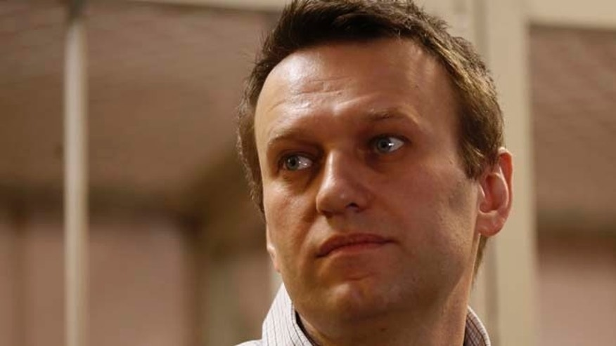 Dec. 30, 2014: Russian opposition activist and anti-corruption crusader Alexei Navalny, 38,  stands at a court in Moscow, Russia, Tuesday. Alexei Navalny, the anti-corruption campaigner who is a leading foe of Russian President Vladimir Putin, has been found guilty of fraud and given a suspended sentence of three and a half years.