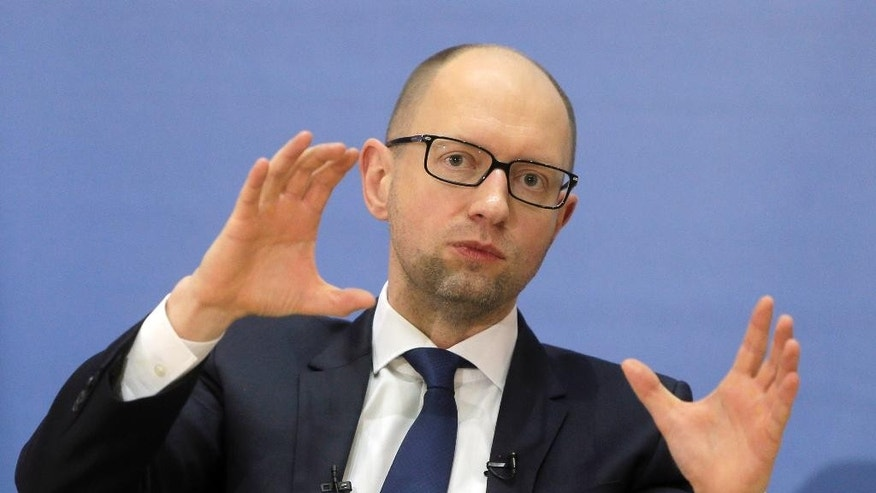 Ukrainian Prime Minister Arseniy Yatsenyuk  gestures, during a press conference in Kiev, Ukraine, Tuesday, Dec. 30, 2014. (AP Photo/Efrem Lukatsky)