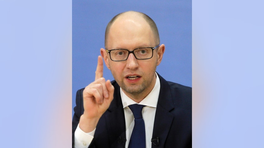Ukrainian Prime Minister Arseniy Yatsenyuk speaks to media during a press conference in Kiev, Ukraine, Tuesday, Dec. 30, 2014.  (AP Photo/Efrem Lukatsky)