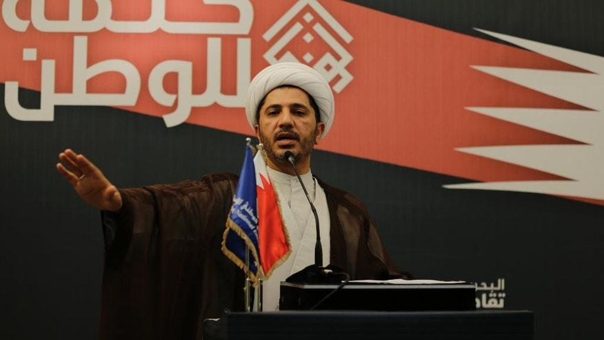 FILE - In this Thursday, Nov. 12, 2014 file photo, Sheik Ali Salman, head of the main Shiite opposition group Al-Wefaq which is boycotting Saturday's parliamentary elections, urges Bahrainis to stay away from the polls and calls on the government to free all political prisoners during a public address in Manama, Bahrain. A lawyer for the leader of Bahrain's largest Shiite opposition group said Sunday, Dec. 28, 2014 that Sheik Ali Salman is being held by the Interior Ministry, which is accusing him of inciting hatred against the government and calling for its overthrow by force. (AP Photo/Hasan Jamali, File)