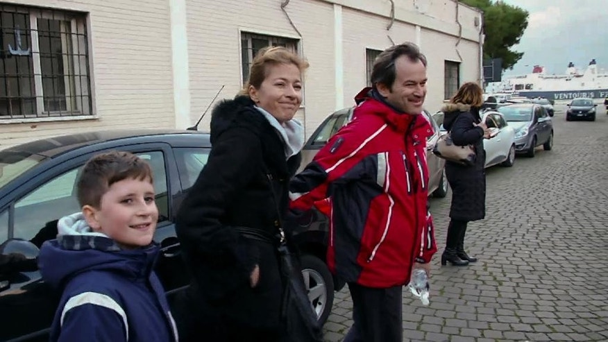 In this frame taken from a video, from right, Nassos Tsonas, his wife Natasha and their 11-year-old Sebastian walk in the port of Bari, southern Italy, Monday, Dec. 29, 2014, after being rescued from the burning Italian flagged ferry Norman Atlantic. The ferry, underway from the Greek port of Patras to the Italian port of Ancona on the Adriatic,  carrying nearly 500 people, caught fire off the Greek island of Corfu early Sunday, trapping passengers on the top decks as gale-force winds and choppy seas hampered the evacuation. Nothing could have prepared the Tsonas family for the terror it would encounter back home on Corfu, an idyllic Greek island beloved of tourists, writers and artists. (AP Photo/APTN)
