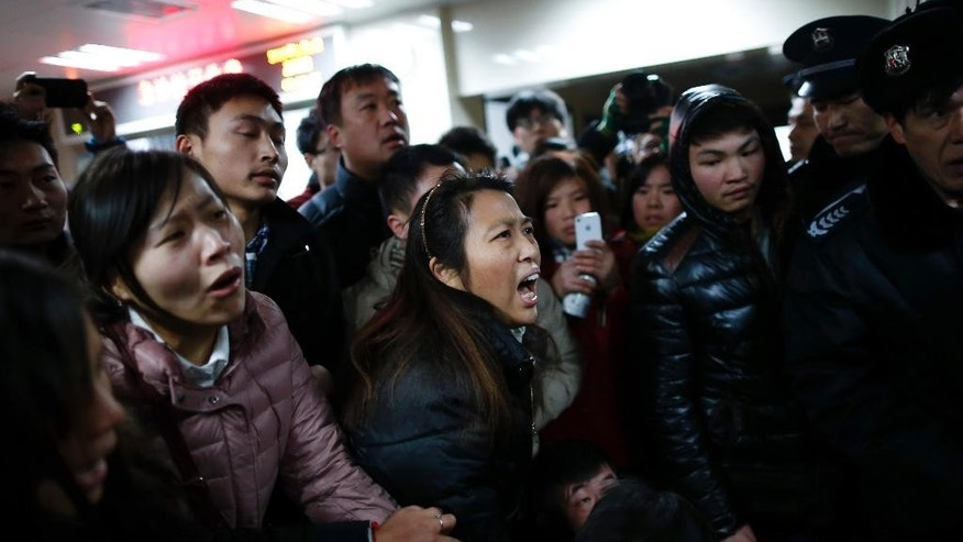 Relatives try to seek information at a hospital where those injured in a stampede are being treated in Shanghai, China, Thursday Jan. 1, 2015. Dozens died in a stampede during New Year's celebrations in downtown Shanghai, city officials said - the worst disaster to hit one of China's showcase cities in recent years. (AP Photo) CHINA OUT