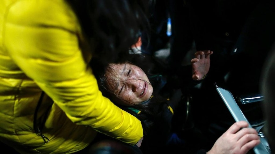 A woman grieves at a hospital where those injured by a stampede are being treated in Shanghai, China, Thursday Jan. 1, 2015. Dozens died in a stampede during New Year's celebrations in downtown Shanghai, city officials said - the worst disaster to hit one of China's showcase cities in recent years. (AP Photo) CHINA OUT