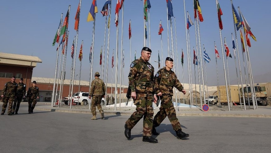 French soliders leave after a handover ceremony, at the Hamid Karzai Airport, in Kabul, Afghanistan, Wednesday, Dec. 31, 2014. (AP Photo/Rahmat Gul)