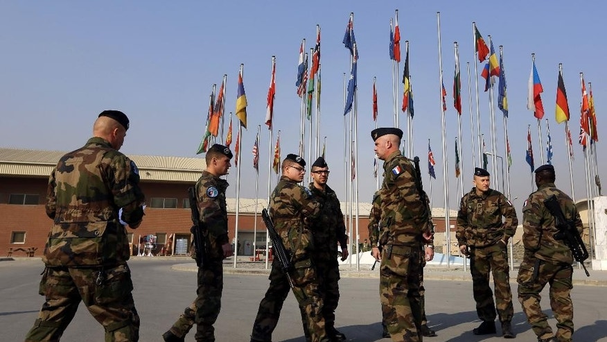 French soliders gather after a handover ceremony, at the Hamid Karzai Airport, in Kabul, Afghanistan, Wednesday, Dec. 31, 2014. (AP Photo/Rahmat Gul)