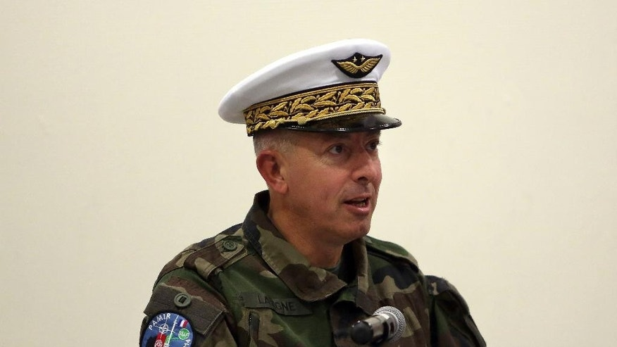Brig. Philippe Lavigne, speaks during a handover ceremony, at the Hamid Karzai Airport, in Kabul, Afghanistan, Wednesday, Dec. 31, 2014. (AP Photo/Rahmat Gul)