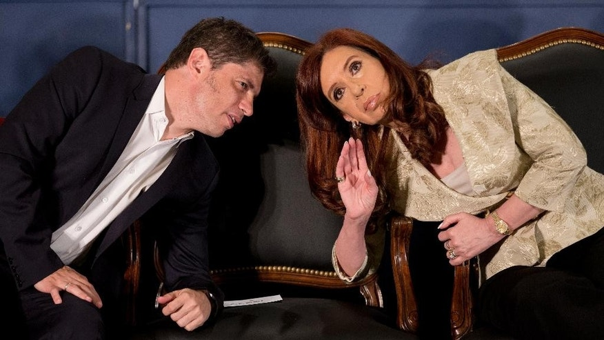 FILE - In this Aug. 20, 2014 file photo, Argentina's President Cristina Fernandez, right, speaks with her Economy Minister Axel Kicillof during a ceremony for the 160th anniversary of the Buenos Aires Stock Exchange in Buenos Aires, Argentina. The Argentine government and a group of holdout bond creditors led by billionaire Paul Singer will soon have a chance to renegotiate a longstanding dispute that U.S. courts and the U.N. have wrestled with and that could ultimately have a large impact on debt restructuring worldwide. The so-called Rights Upon Future Offers clause, which obligates Argentina to match the terms of any new bond negotiations for old creditors, expires Jan. 1. (AP Photo/Victor R. Caivano, File)