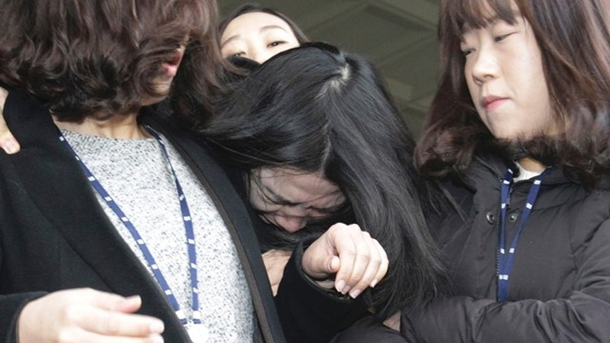 Dec. 30, 2014: Cho Hyun-ah, center, former vice president of Korean Air Lines, is escorted by court officials as she leaves for the Seoul Western District Prosecutors Office. (AP Photo/Ahn Young-joon)