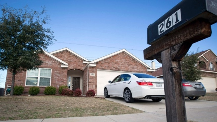 This Monday, Dec. 29, 2014 photo shows the home where officers responding to a report of a suicide attempt found four people dead in Crowley, Texas Sunday, Dec. 28, 2014. Crowley Police Chief Luis Soler said in a news conference Sunday night that a 9-year-old who was inside the home called a relative and told her that a man there was injured after attempting to kill himself. (AP Photo/ Fort Worth Star-Telegram,Joyce Marshall)