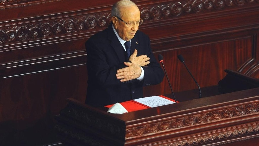 Beji Caid Essebsi, acknowledges the applauses after swearing in as new Tunisian President during a ceremony at the National Assembly in Tunis, Tunisia, Wednesday, Dec. 31, 2014. Tunisia's new president pledged a rule of reconciliation and consensus as he took his oath Wednesday before the newly elected parliament to complete the country's democratic transition. The inauguration of Beji Caid Essebsi, an 88-year-old political veteran, comes in a year in which Tunisians wrote a new constitution and elected a new parliament and president, ending a transition kicked off by a revolution. (AP Photo/Hassene Dridi)