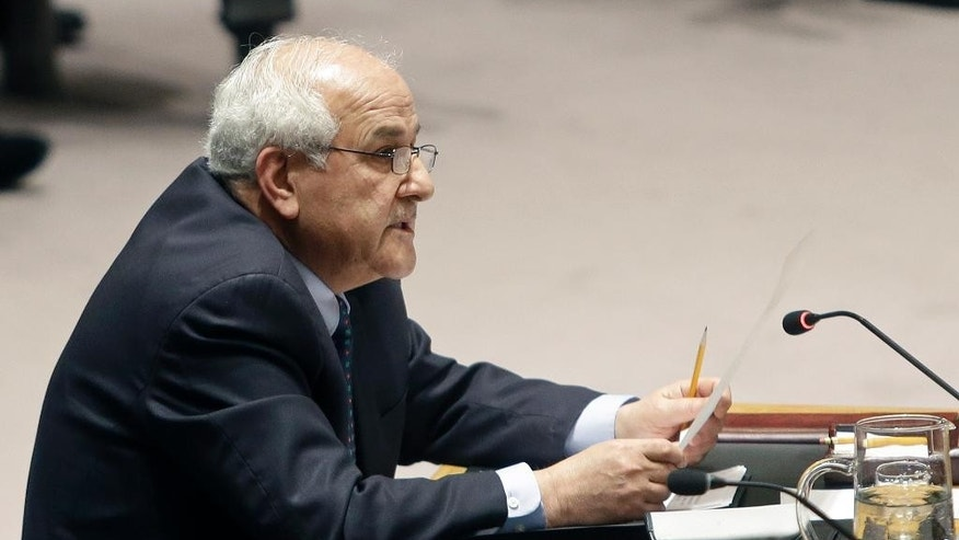 Palestinian Ambassador to the United Nations Riyad Mansour speaks during a meeting of the U.N. Security Council Tuesday, Dec. 30, 2014, at the United Nations headquarters. The United Nations Security Council has rejected a Palestinian resolution demanding an end to Israeli occupation within three years Tuesday. (AP Photo/Frank Franklin II)
