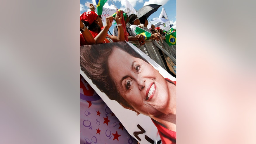 Supporters of President Dilma Rousseff await the beginning of the inauguration ceremony in the Tres Poderes Plaza, in Brasilia, Brazil, Thursday, Jan. 1, 2015. Brazil's President Rousseff will be sworn into her second term in office, during an official ceremony at the Planalto Presidential Palace. (AP Photo/Beto Barata)