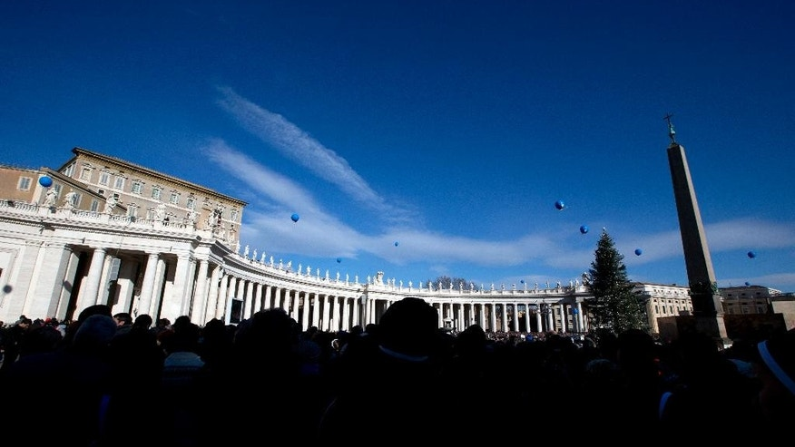 People crowd St. Peter's Square at the Vatican as Pope Francis delivers his blessing during the Angelus noon prayer he delivered from the window of his studio, Thursday, Jan. 1, 2015. (AP Photo/Andrew Medichini)