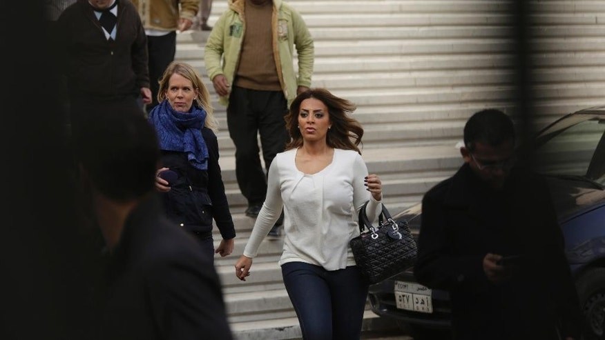 Marwa Omara, the fiancée of Egyptian-Canadian Al-Jazeera English journalist Mohammed Fahmy, leaves the high court after a hearing in Cairo, Egypt, Thursday, Jan. 1, 2015. An Egyptian appeals court ordered a retrial Thursday in the case of three imprisoned Al-Jazeera English journalists, a widely expected move in a highly politicized case infested with loopholes. (AP Photo/Nariman El-Mofty)