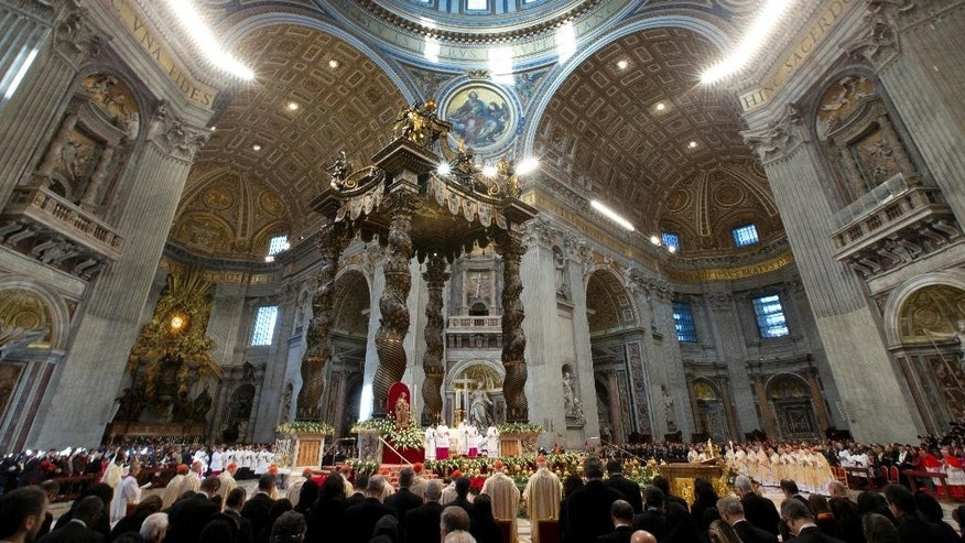 Pope Francis celebrates a New Year mass in St. Peter's Basilica at the Vatican, Thursday, Jan. 1, 2015. (AP Photo/Andrew Medichini)