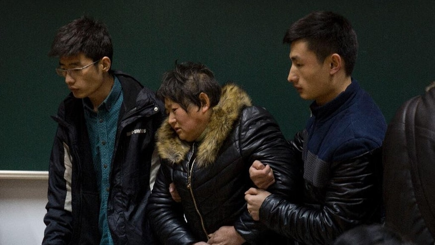 Relatives of a victim of the deadly stampede arrives at a room to wait for answers in Shanghai, China, Friday, Jan. 2, 2015. People unable to contact friends and relatives streamed into hospitals Thursday, anxious for information after a stampede during New Year's celebrations in Shanghai's historic waterfront area killed 36 people in the worst disaster to hit one of China's showcase cities in recent years. (AP Photo/Ng Han Guan)