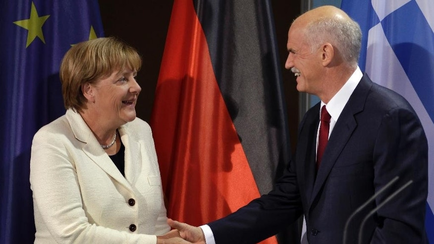 In this Tuesday, Sept. 27, 2011 file photo, German Chancellor Angela Merkel, left, and the Prime Minister of Greece, George Papandreou, right, shake hands after a statement prior to a dinner at the chancellery in Berlin, Germany. Former Greek prime minister George Papandreou has revealed plans to create a new political party — a development that will see him break away from the once powerful PanHellenic Socialist Movement founded by his father. Papandreou, 62, announced the plan on his website Friday, Jan. 2, 2015, ahead of a snap general election on Jan. 25. (AP Photo/Michael Sohn, File)