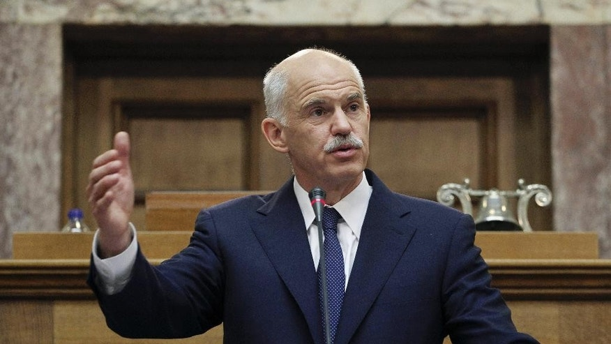 FILE - In this Thursday, Nov. 3, 2011 file photo Greek Prime Minister George Papandreou addresses Socialist lawmaker members of parliament in Athens, in Athens, on Thursday, Nov. 3, 2011. Former Greek prime minister George Papandreou has revealed plans to create a new political party — a development that will see him break away from the once powerful PanHellenic Socialist Movement founded by his father. Papandreou, 62, announced the plan on his website Friday, Jan . 2 , 2015, ahead of a snap general election on Jan. 25. (AP Photo/Petros Giannakouris, File)