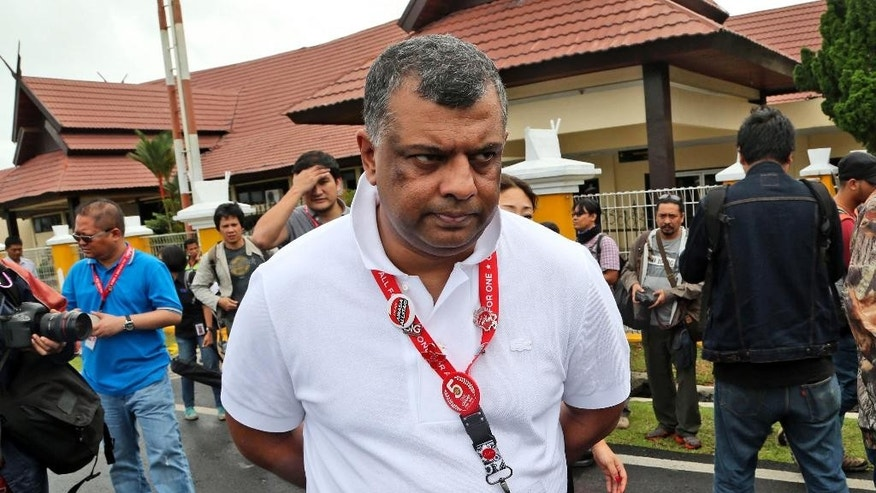 FILE - In this Wednesday, Dec. 31, 2014 file photo, AirAsia Group CEO Tony Fernandes walks upon arrival to visit the command center of the search operation for the victims of AirAsia Flight 8501 at the airport in Pangkalan Bun. From the highly visible compassion shown by Fernandes to details such as changing the airline's bright red logo to a somber gray online, experts say the Malaysia-based budget carrier's initial response to the tragedy is a textbook example of how to communicate in a crisis. (AP Photo/Tatan Syuflana, File)