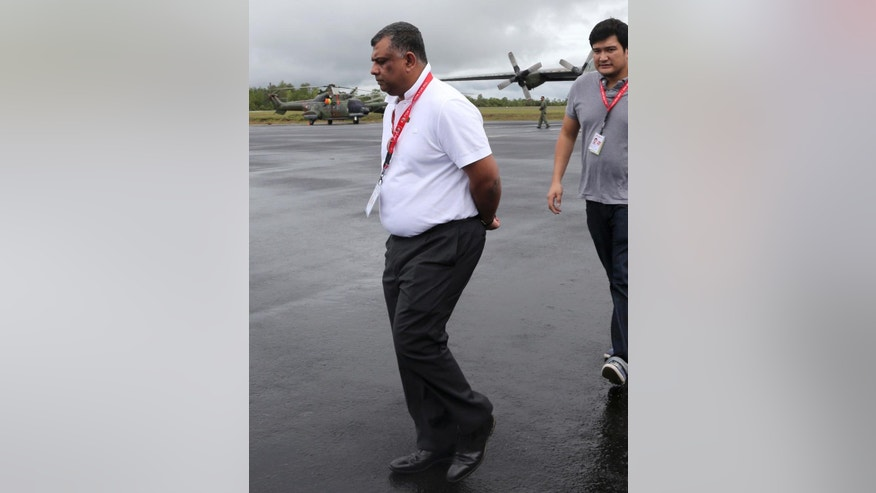 In this Wednesday, Dec. 31, 2014 photo, AirAsia Group CEO Tony Fernandes walks upon his arrival to visit the command center of the search operation for the victims of AirAsia Flight 8501 at the airport in Pangkalan Bun, Indonesia. From the highly visible compassion shown by Fernandes to details such as changing the airline's bright red logo to a somber gray online, experts say the Malaysia-based budget carrier's initial response to the tragedy is a textbook example of how to communicate in a crisis. (AP Photo/Tatan Syuflana)