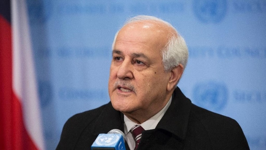 In this photo provided by the United Nations, Palestinian Ambassador to the U.N. Riyad Mansour addresses the media at U.N. headquarters after submitting documents to join the International Criminal Court on Friday, Jan. 2, 2015. The Palestinians moved quickly to join the court after suffering a defeat in the U.N. Security Council, which rejected a resolution Tuesday that would have set a three-year deadline for the establishment of a Palestinian state on lands occupied by Israel. (AP Photo/UN Photo, Evan Schneider)