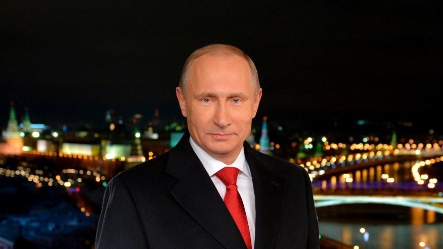 In this undated photo released by Kremlin Press service via RIA Novosti,  Russian President Vladimir Putin looks on during a recording of his annual televised New Year's message in the Kremlin in Moscow, Russia, Wednesday, Jan. 31, 2014, with the Kremlin in the background.  (AP Photo/RIA Novosti, Alexei Druzhinin, Presidential Press Service)