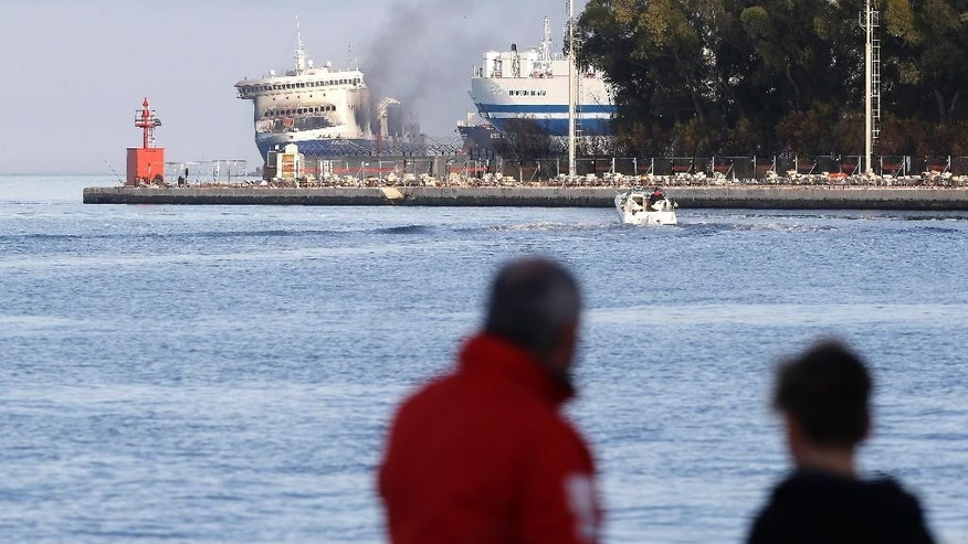 Smoke billows from the Italian-flagged Norman Atlantic ferry after that was towed into the port of Brindisi, southern Italy, Saturday, Jan. 3, 2015. For a second day, fierce heat from a slow-burning blaze kept firefighters and other investigators on Saturday from searching the hold and vehicle decks of a Greek ferry for more bodies. At least 11 people perished in the pre-dawn blaze on Dec. 28 aboard the Norman Atlantic, on a voyage between Greece and Italy. Authorities fear more bodies might be inside the vehicle deck where the fire began. (AP Photo/Antonio Calanni)