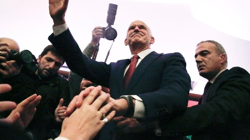 Former Greek Prime Minister George Papandreou waves to a crowd of supporters gathered in Athens, on Saturday Jan. 3, 2015. Papandreou announced the formation of a new party, the Movement of Democrat Socialists, which will contest the Jan. 25 election.(AP Photo/Petros Giannakouris)