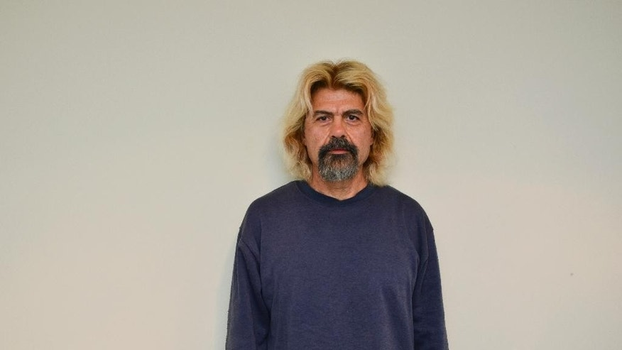 This photo undated provided on Saturday, Jan. 3, 2015, by the Greek police shows convicted terrorist Christodoulos Xiros after his arrest Saturday in a town just outside the capital, Athens. One of Greece's most-wanted fugitives, Xiros was captured Saturday, nearly a year after he failed to return to prison while on a furlough. Xiros is serving six life terms, plus 25-years, for his role as a member of terrorist group 17 November.(AP Photo/Hellenic Police)