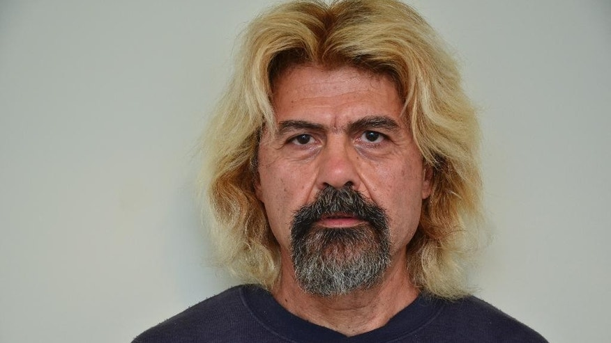 This photo undated provided on Saturday, Jan. 3, 2015, by the Greek police shows convicted terrorist Christodoulos Xiros after his arrest in a town just outside the capital, Athens. One of Greece's most-wanted fugitives, Xiros was captured Saturday, nearly a year after he failed to return to prison while on a furlough. Xiros is serving six life terms, plus 25-years, for his role as a member of terrorist group 17 November.(AP Photo/Hellenic Police)