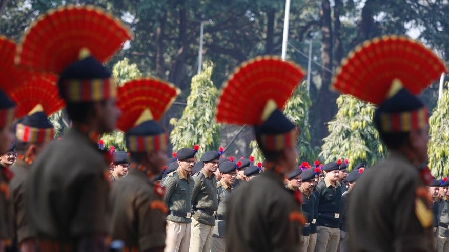 Indian Border Security Force (BSF) soldiers pay homage to their colleague who was killed in a India Pakistan cross border firing, in Jammu, India, Thursday, Jan. 1, 2015. Indian and Pakistani troops exchanged fire Wednesday near the cease-fire line that divides the disputed Himalayan region of Kashmir, leaving two dead on the Pakistani side and one on the Indian side, officials said. (AP Photo/Channi Anand)