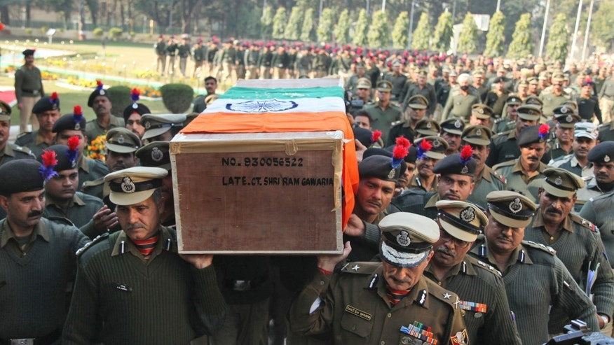 Jan. 1, 2015: Indian Border Security Force (BSF) officers carry the coffin of their colleague who was killed in a India Pakistan cross border firing, in Jammu, India