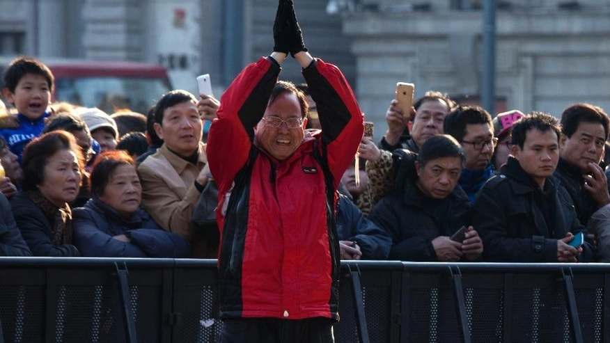 A man cries as he prays for victims of a stampede in Shanghai, China, Friday, Jan. 2, 2015.  Authorities were still investigating the cause of the stampede late Wednesday night, but street vendors, residents, taxi drivers and other witnesses say the city failed to prepare for the massive turnout. (AP Photo/Ng Han Guan)