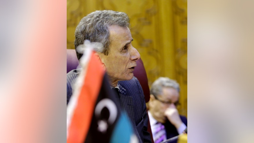 Libyan representative at the Arab League Ashour Abu-Rashed attends an emergency representatives meeting to discuss the conflict in Libya, at the Arab League headquarters in Cairo, Egypt, Monday, Jan. 5, 2015. (AP Photo/Amr Nabil)