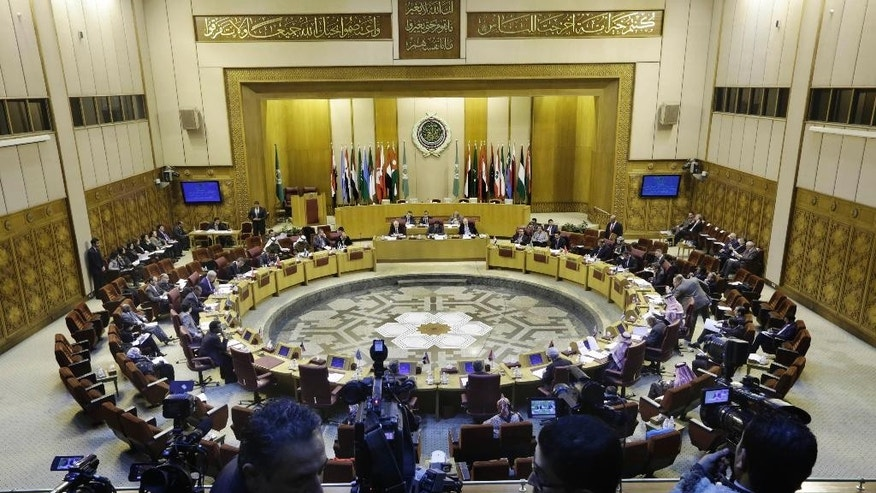 Representatives of the Arab League attend an emergency meeting to discuss the conflict in Libya, at the Arab League headquarters in Cairo, Egypt, Monday, Jan. 5, 2015. (AP Photo/Amr Nabil)
