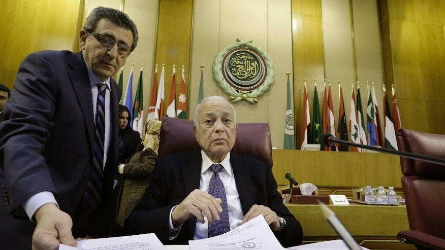 Arab League Secretary General Nabil Elaraby, center, chairs an emergency representatives meeting to discuss the conflict in Libya, at the Arab League headquarters in Cairo, Egypt, Monday, Jan. 5, 2015. (AP Photo/Amr Nabil)